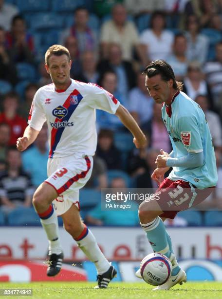 Crystal Palace's Clint Hill and Burnley's Chris Eagles battle for the ball during the CocaCola Football Championship match at Selhurst Park London