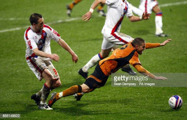 Crystal Palace's Clint Hill fouls Wolves player Michael Kightly for a penlty during the CocaCola Championship match at Selhurst Park London