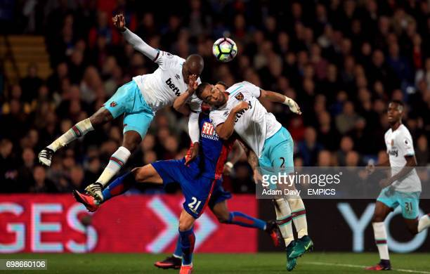 Crystal Palace's Connor Wickham battles for the ball with West Ham United's Angelo Ogbonna and Winston Reid