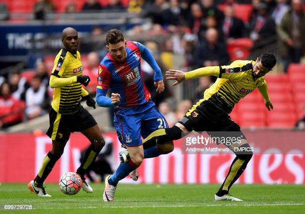 Crystal Palace's Connor Wickham goes down in the area after a challenge from Watford's Miguel Angel Britos