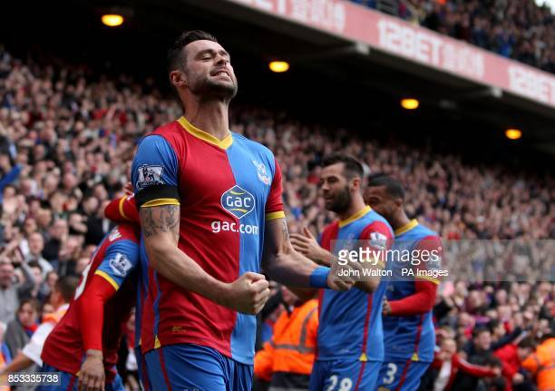 Crystal Palace's Damien Delaney celebrates after teammate Jason Puncheon scored the only goal of the game during the Barclays Premier League match at...