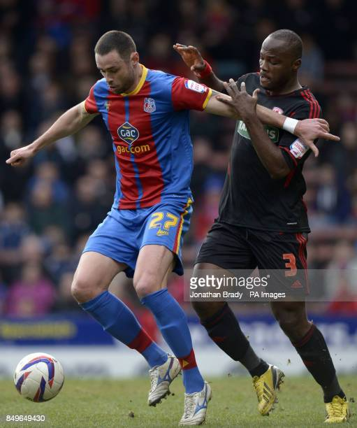 Crystal Palace's Damien Delaney holds back Middlesbrough's Andre Bikey during the npower Football League Championship match at Selhurst Park London