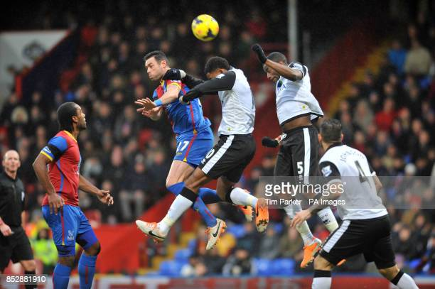 Crystal Palace's Damien Delaney is challenged by Norwich City's Leroy Fer and Sebastien Bassong during the Barclays Premier League match at Selhurst...