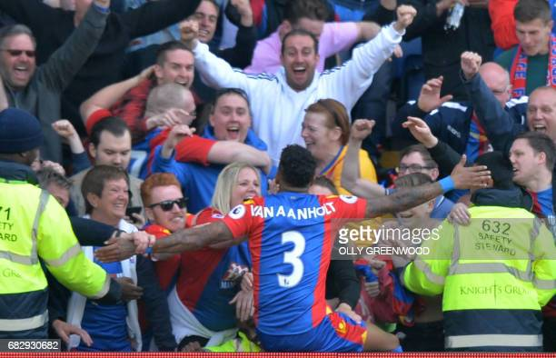 Crystal Palace's Dutch defender Patrick van Aanholt celebrates with fans scoring the fourth goal during the English Premier League football match...