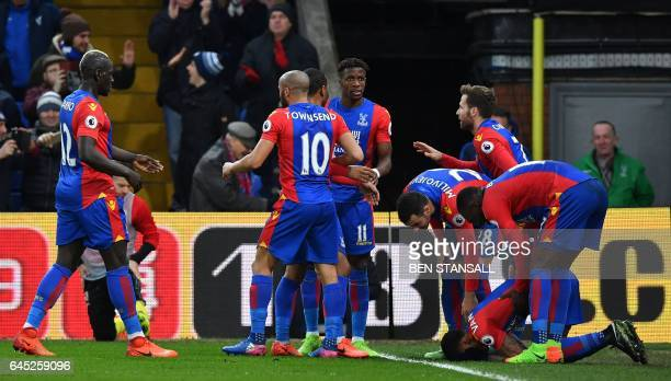 Crystal Palace's Dutch defender Patrick van Aanholt kneels on the pitch as he celebrates scoring his team's first goal during the English Premier...