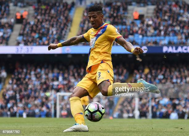 Crystal Palace's Dutch defender Patrick van Aanholt shoots but fails to score during the English Premier League football match between Manchester...