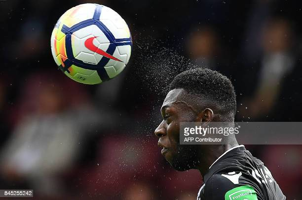 TOPSHOT Crystal Palace's Dutch defender Timothy FosuMensah heads the ball during the English Premier League football match between Burnley and...