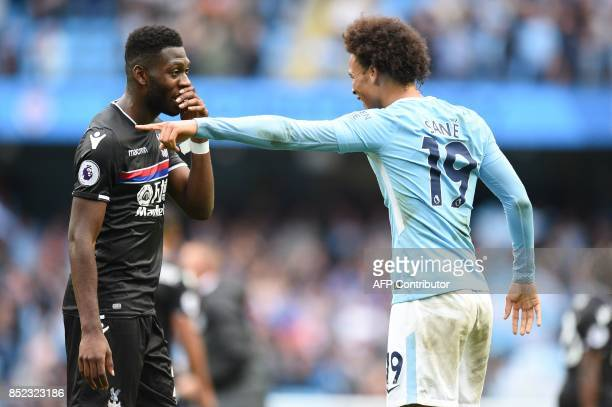 Crystal Palace's Dutch defender Timothy FosuMensah shares a joke with Manchester City's German midfielder Leroy Sane after the English Premier League...