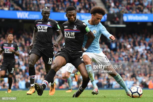Crystal Palace's Dutch defender Timothy FosuMensah vies with Manchester City's German midfielder Leroy Sane during the English Premier League...