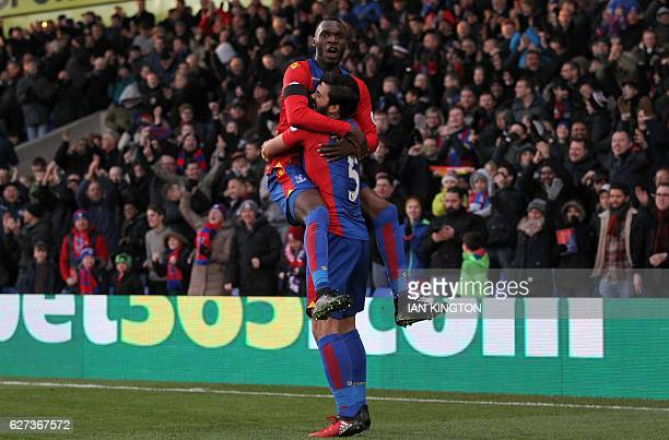 Crystal Palace's English defender James Tomkins celebrates scoring his team's second goal with Crystal Palace's Zaireborn Belgian striker Christian...