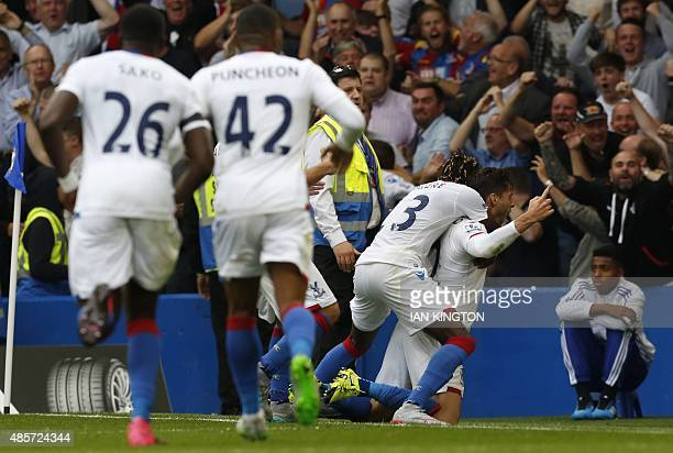 Crystal Palaces English defender Joel Ward celebrates with teammates after scoring their second goal during the English Premier League football match...