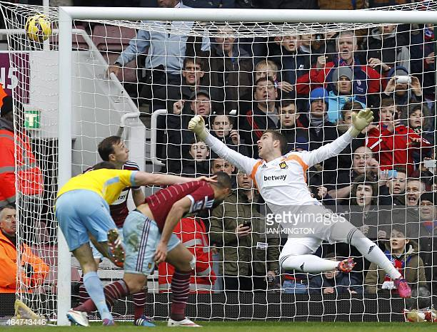 Crystal Palace's English defender Scott Dann scores with this header a 02 beating West Ham United's Spanish goalkeeper Adrian during the English...