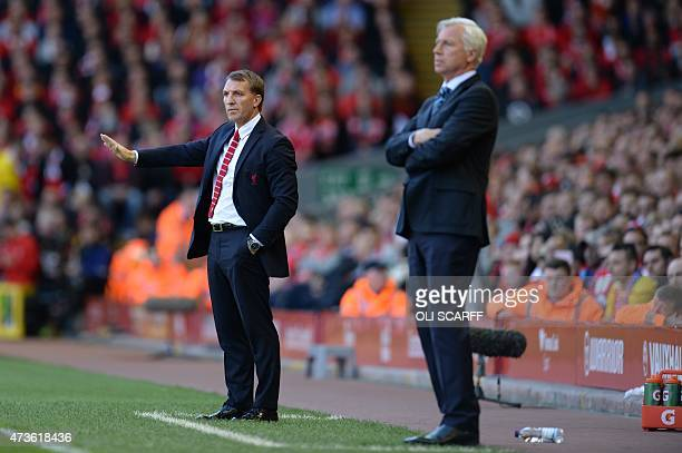Crystal Palace's English manager Alan Pardew watches as Liverpool's Northern Irish manager Brendan Rodgers gestures on the touchline during the...
