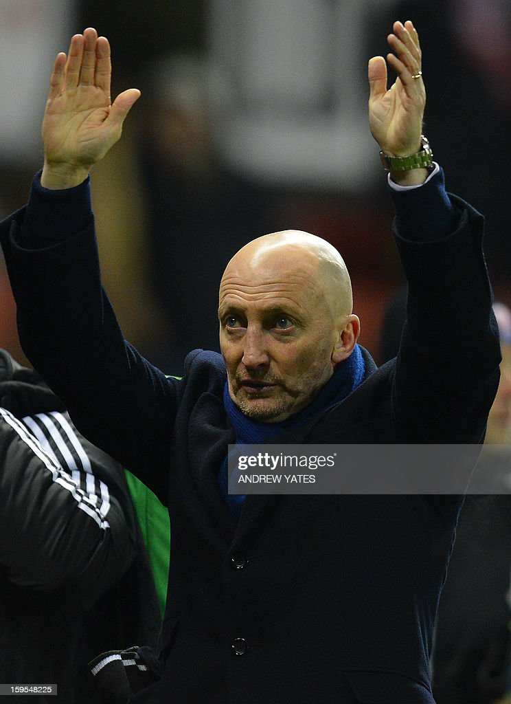 """Crystal Palace's English manager Ian Holloway reacts as he leaves the pitch following 4-1 defeat during the English FA Cup third round replay football match between Stoke City and Crystal Palace at the Britannia stadium, Stoke-on-Trent, central England, on January 15, 2013. USE. No use with unauthorized audio, video, data, fixture lists, club/league logos or """"live"""" services. Online in-match use limited to 45 images, no video emulation. No use in betting, games or single club/league/player publications."""