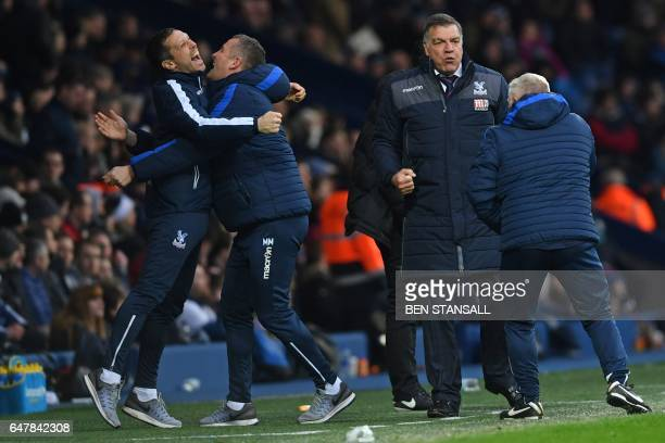 Crystal Palace's English manager Sam Allardyce and assistants celebrate their second goal during the English Premier League football match between...