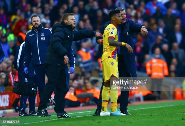 Crystal Palace's English manager Sam Allardyce gives advice to Crystal Palace's Dutch defender Patrick van Aanholt as he comes onto the pitch during...