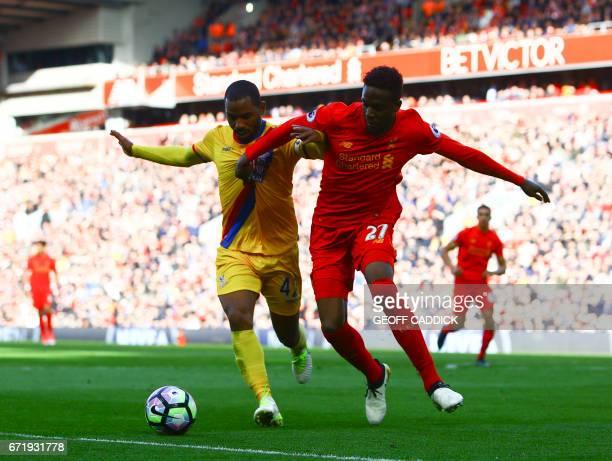 Crystal Palace's English midfielder Jason Puncheon vies with Liverpool's Belgian striker Divock Origi during the English Premier League football...