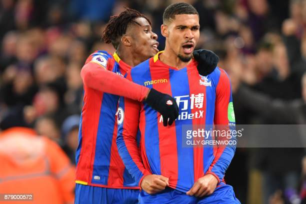 Crystal Palace's English midfielder Ruben LoftusCheek celebrates scoring their first goal with Crystal Palace's Ivorian striker Wilfried Zaha during...