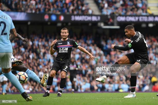 Crystal Palace's English midfielder Ruben LoftusCheek hits the post during the English Premier League football match between Manchester City and...