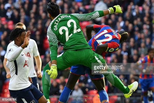 Crystal Palace's French midfielder Mamadou Sakho shoots but fails to score against Tottenham Hotspur's Argentinian goalkeeper Paulo Gazzaniga during...