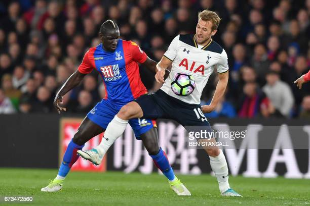 Crystal Palace's French midfielder Mamadou Sakho vies with Tottenham Hotspur's English striker Harry Kane during the English Premier League football...
