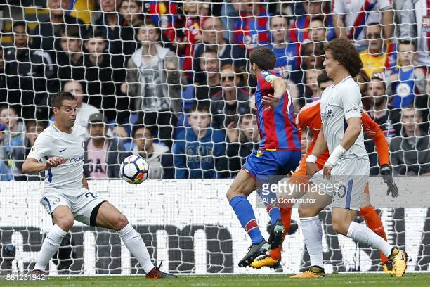 Crystal Palace's French midfielder Yohan Cabaye hits a deflected shot off Chelsea's Spanish defender Cesar Azpilicueta to open the scoring Crystal...