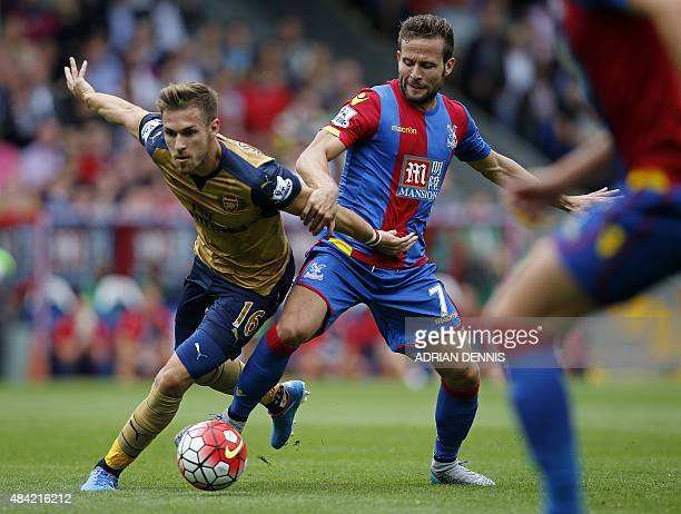 Crystal Palace's French midfielder Yohan Cabaye vies with Arsenal's Welsh midfielder Aaron Ramsey during of the English Premier League football match...