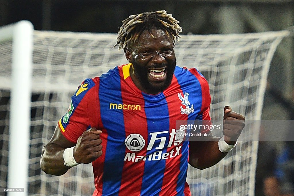 Crystal Palaces French-born Malian midfielder Bakary Sako celebrates after scoring the opening goal of the English League Cup third round football match between Crystal Palace and Huddersfield Town at Selhurst Park in south London on September 19, 2017. / AFP PHOTO / Glyn KIRK / RESTRICTED TO EDITORIAL USE. No use with unauthorized audio, video, data, fixture lists, club/league logos or 'live' services. Online in-match use limited to 75 images, no video emulation. No use in betting, games or single club/league/player publications. /