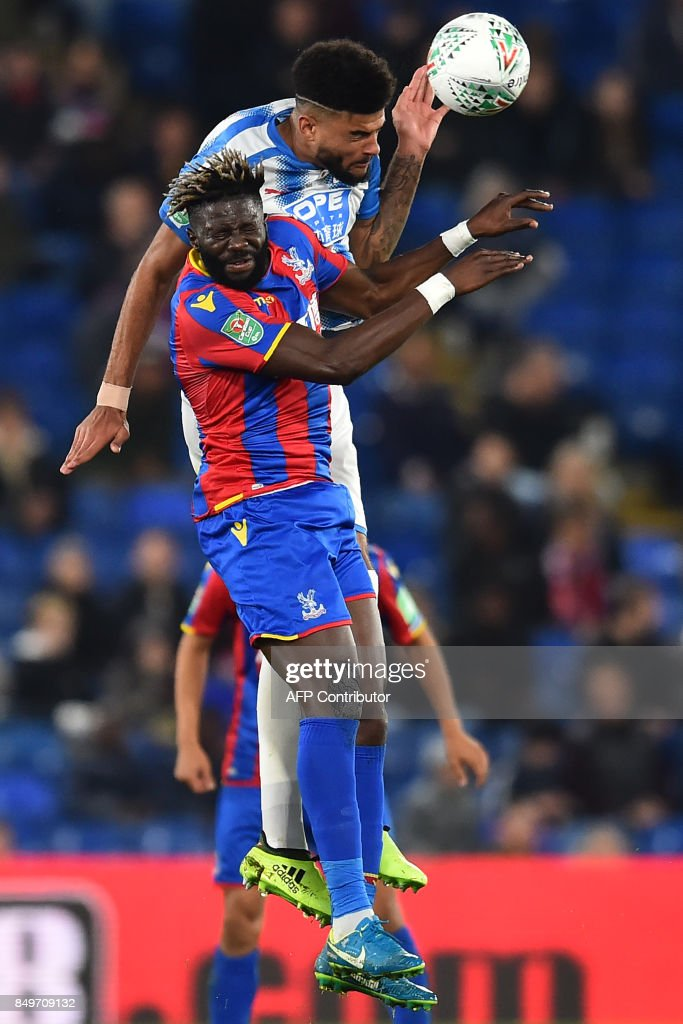 Crystal Palaces French-born Malian midfielder Bakary Sako vies with Huddersfield Town's Danish midfielder Philip Billing (R) during the English League Cup third round football match between Crystal Palace and Huddersfield Town at Selhurst Park in south London on September 19, 2017. / AFP PHOTO / Glyn KIRK / RESTRICTED TO EDITORIAL USE. No use with unauthorized audio, video, data, fixture lists, club/league logos or 'live' services. Online in-match use limited to 75 images, no video emulation. No use in betting, games or single club/league/player publications. /