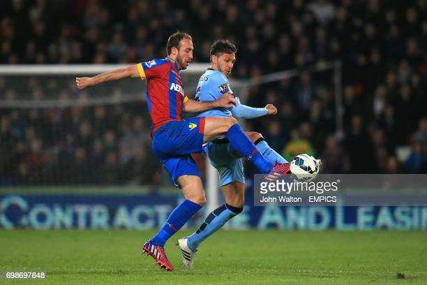 Crystal Palace's Glenn Murray and Manchester City's Martin Demichelis battle for the ball