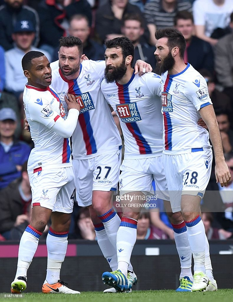Crystal Palace's Irish defender Damien Delaney (2nd L) celebrates with Crystal Palace's English midfielder Jason Puncheon (L), Crystal Palace's Australian midfielder Mile Jedinak (2nd R) and Crystal Palace's Welsh midfielder Joe Ledley (R) after scoring the opening goal during the English Premier League football match between West Ham United and Crystal Palace at The Boleyn Ground in Upton Park, in east London on April 2, 2016. / AFP / OLLY GREENWOOD / RESTRICTED TO EDITORIAL USE. No use with unauthorized audio, video, data, fixture lists, club/league logos or 'live' services. Online in-match use limited to 75 images, no video emulation. No use in betting, games or single club/league/player publications. /