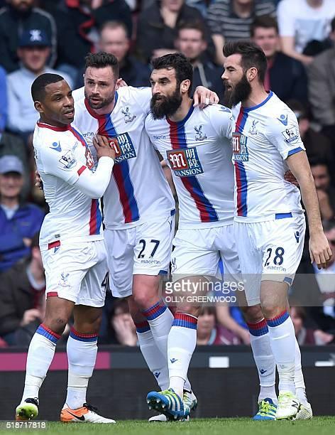 Crystal Palace's Irish defender Damien Delaney celebrates with Crystal Palace's English midfielder Jason Puncheon Crystal Palace's Australian...