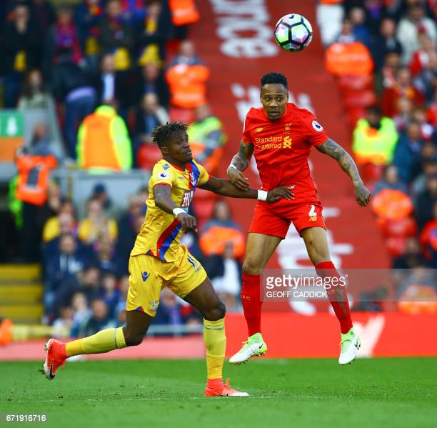 Crystal Palace's Ivorian striker Wilfried Zaha vies with Liverpool's English defender Nathaniel Clyne during the English Premier League football...
