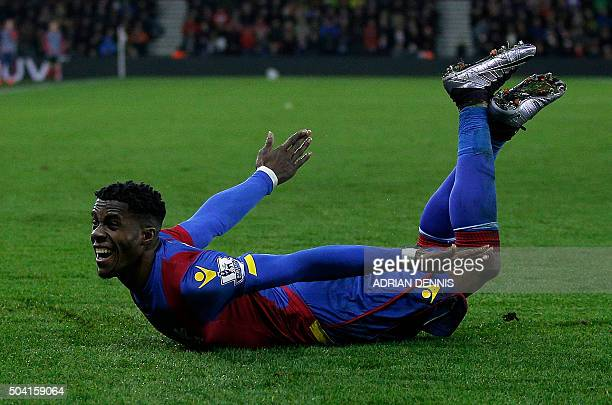 TOPSHOT Crystal Palace's Ivorianborn English striker Wilfried Zaha celebrates scoring his team's second goal during the FA Cup thirdround football...