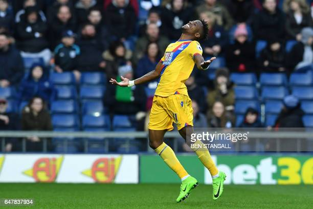 Crystal Palace's Ivorianborn English striker Wilfried Zaha celebrates after scoring the opening goal of the English Premier League football match...