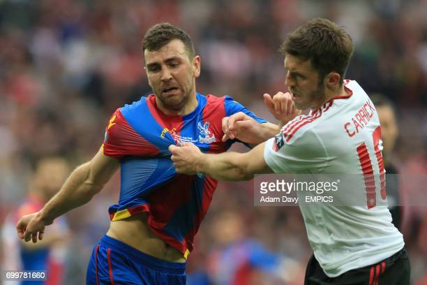 Crystal Palace's James MacArthur has his shirt pulled by Manchester United's Michael Carrick