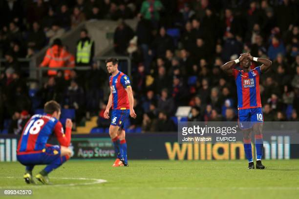 Crystal Palace's James McArthur Scott Dann and Yannick Bolasie are dejected at the final whistle