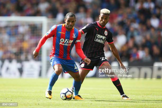 Crystal Palace's Jason Puncheon and Huddersfield Town's Steve Mounie during the Premier League match at Selhurst Park London