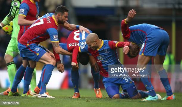 Crystal Palace's Jason Puncheon is congratulated by teammates Damien Delaney Adlene Guedioura and Marouane Chamakh during the Barclays Premier League...