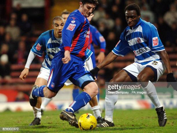 Crystal Palace's Jon Macken shoots under pressure from Reading's Ibrahima Sonko during the CocaCola Championship match at Selhurst Park London Friday...
