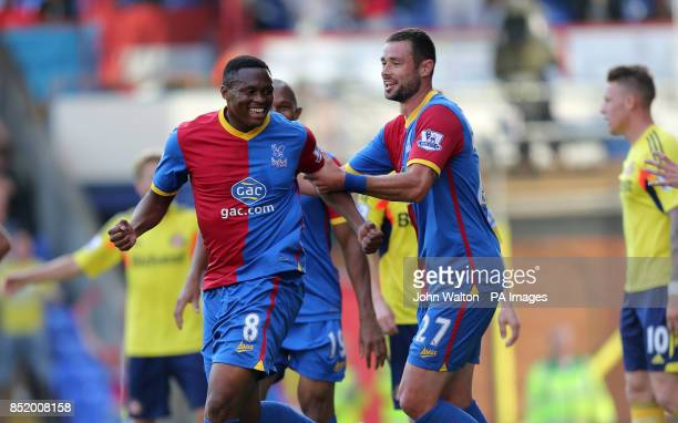 Crystal Palace's Kagisho Dikgacoi celebrates with teammate Damien Delaney after teammate Danny Gabbidon scores the opening goal of the game during...