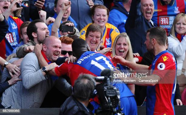 Crystal Palace's Luka Milivojevic and Christian Benteke celebrate with the fans after their third goal during the Premier League match between...