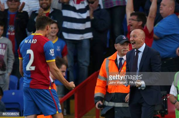 Crystal Palace's manager Ian Holloway celebrates victory at the final whistle with Joel Ward following the Barclays Premier League match at Selhurst...