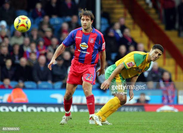 Crystal Palace's Marco Reich and Norwich City's Youssef Safri battle for the ball during the CocaCola Championship match at Selhurst Park London