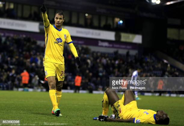 Crystal Palace's Marouane Chamakh celebrates scoring the second goal with fans as Yannick Bolasie who set up the goal on the floor during the FA Cup...