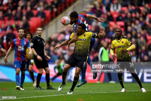 Crystal Palace's Mile Jedinak and Watford's Troy Deeney battle for the ball