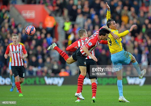 Crystal Palace's Moroccan striker Marouane Chamakh vies with Southampton's English midfielder Jack Cork during the FA Cup fourth round football match...