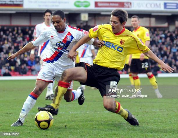 Crystal Palace's Nathaniel Clyne and Jon Harley in action during the FA Cup Fourth Round at Vicarage Road Watford