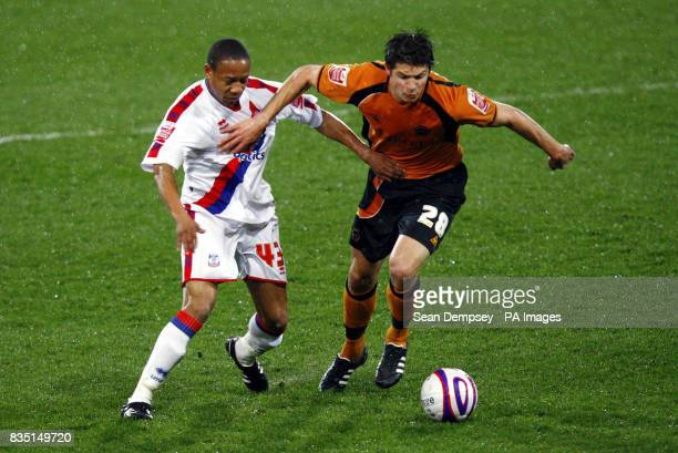 Crystal Palace's Nathaniel Clyne battles for the ball with Wolves player Goerge Friend during the CocaCola Championship match at Selhurst Park London