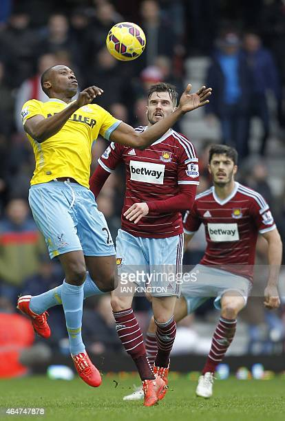 Crystal Palace's Nigerian striker Shola Ameobi vies with West Ham United's English midfielder Carl Jenkinson during the English Premier League...